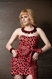 Strict girl blonde in leopard dress Royalty Free Stock Image