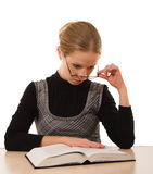 Strict girl reading a book on a white background. Strict young girl reading a book on a white background royalty free stock photos