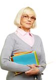 Strict lecturer. Female lecturer ready for a lesson looking strictly at camera Royalty Free Stock Photo