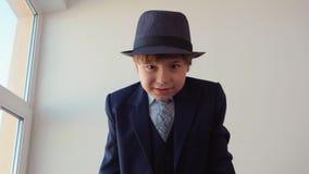 Strict little boy looks like a boss swears on camera. stock video footage
