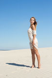 Strict look of a confident woman in the desert stock images