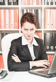 Strict middle age business woman. At office Stock Images