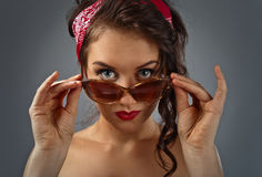 Strict mistress with sunglasses. Young beautiful woman with sunglasses , studio shot Stock Images