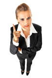 Strict modern business woman shaking her finger. Full length portrait of strict modern business woman shaking her finger isolated on white Royalty Free Stock Images
