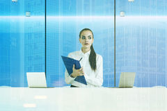 Strict receptionist clipboard blue office double Stock Photography
