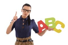 Strict schoolmistress teaching alphabet Stock Photography