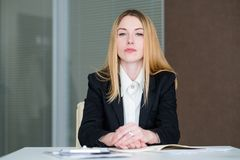 Serious company manager confident business lady. Strict and serious company manager. confident business lady in office workspace stock image