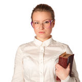 Strict teacher with big book. Isolated on white royalty free stock photography