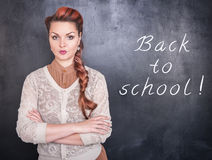 Strict teacher on blackboard background Royalty Free Stock Image