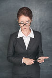 Strict teacher with pointer. Looking at someone stock photos