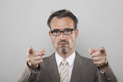 Strict teacher points his forefingers on you. Strict teacher trainer points his fingers to the front royalty free stock photography