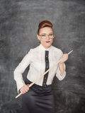 Strict teacher with wooden pointer Stock Photo