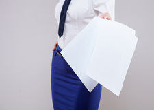 Strict unrecognizable businesswoman holding documents carelessy Stock Photo