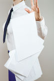 Strict unrecognizable businesswoman throwing out documents carel Stock Photography