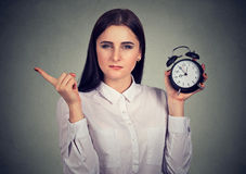 Strict woman with alarm clock Royalty Free Stock Photo
