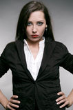 Strict woman in black jacket Stock Image