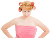 The strict woman in curlers Royalty Free Stock Photo