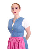 Strict woman isolated in a dirndl Stock Images