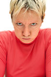 Strict woman. serious looking with puffed up cheek Royalty Free Stock Photo