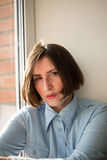 Strict woman with short hair caret in the blue shirt.  Stock Images