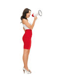 Strict woman shouting in megaphone Royalty Free Stock Images