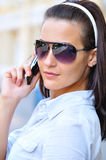 Strict woman is talking phone Royalty Free Stock Image