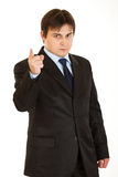 Strict young businessman shaking his finger Stock Image