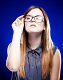 Strict young woman holding nerd glasses Royalty Free Stock Image