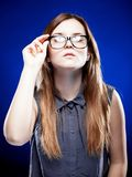 Strict young woman holding nerd glasses Stock Image