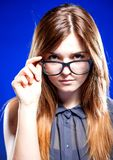 Strict young woman with nerd glasses Stock Images