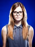 Strict young woman with nerd glasses Royalty Free Stock Images