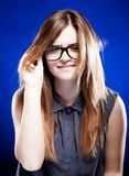 Strict young woman with nerd glasses, giddy grimace Royalty Free Stock Photos