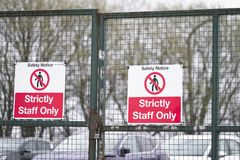Strictly staff parking only sign on private office car park fence. Uk stock photo