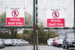 Strictly staff parking only sign on private office car park fence. Uk royalty free stock photos