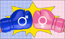 Striden av könsbestämmer föreställt med två motsättande boxninghandskar Arkivbild