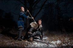 Striden mellan medeltida riddare i stilen av leken av Thro Royaltyfria Bilder