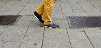 Striding feet with sport shoes Royalty Free Stock Images