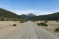 Stright gravel road in Spain Royalty Free Stock Photo
