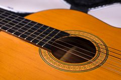 Strigs of acoustic spanish guitar, close up. Acoustic spanish guitar in case, classical musical instrumet, close up, strings Royalty Free Stock Photo