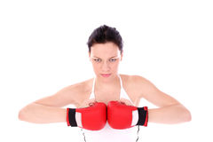 Strike. Woman in gym with gloves Stock Photo