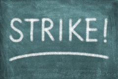Strike. Green chalkboard with lettering strike stock photography