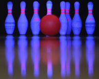 Strike!?. A bowling ball just about to hit the pins Stock Photography