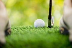 Strike the golf ball Stock Photos