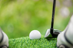 Strike the golf ball. Golfer ready to strike the golf ball Stock Image