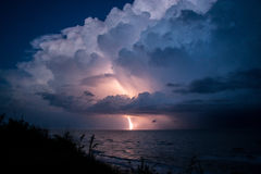 Strike of lightning from big beautiful cloud after storm Royalty Free Stock Images