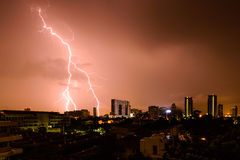 Strike of lightning into building in city Stock Image