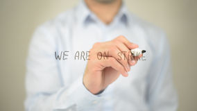 We Are On Strike , man writing on transparent screen Stock Image