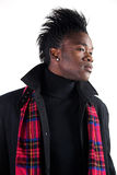 Strike a pose. Portrait of a young black man in casual attire royalty free stock photography