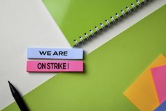 We Are on Strike! text on top view office desk table of Business workplace and business objects royalty free stock photography