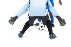 Striker hitting football at goalkeeper Royalty Free Stock Image
